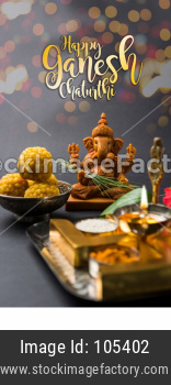 Happy Ganesh Chaturthi Greeting Card showing photograph of lord ganesha idol with pooja or puja thali, bundi laddu/modak, durva