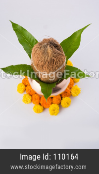 copper kalash with coconut and mango leaf with floral decoration