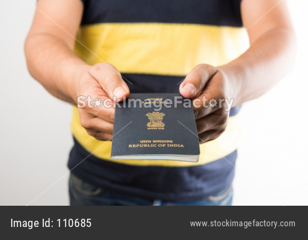 Hand holding Indian Passport