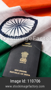 Indian passport placed over tricolour Flag