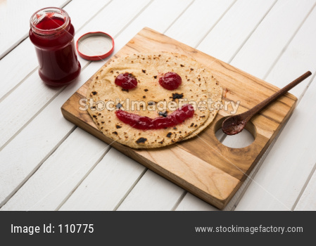 Indian Kids tiffin menu Chapati with Jam or Ketchup with smily