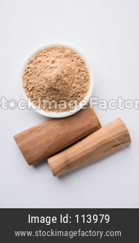 Chandan or sandalwood powder with sticks and traditional mortar