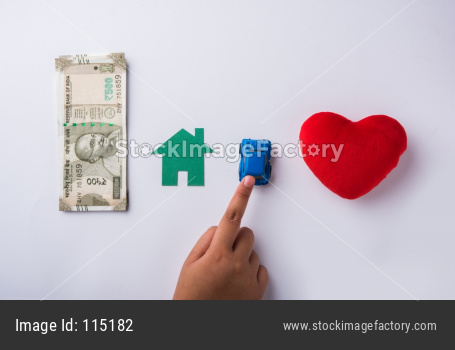 hand choosing between Indian money, house, car and love or healthcare