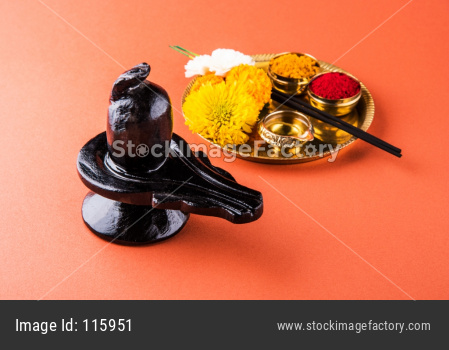 Maha Shivaratri concept with Shiva Linga and flowers with Haldi Kumkum