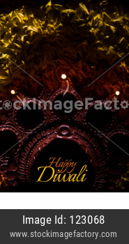 happy diwali greeting card showing Clay Diya over flower rangoli