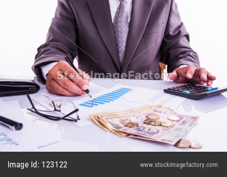 India and accounting concept showing accountant working on Income tax forms with currency notes, calculator and house/car 3d Mod