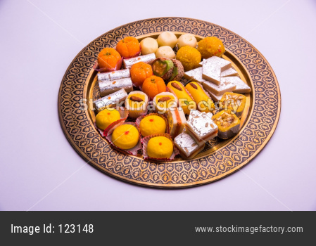 Laxmi Puja with dry fruits, Indian rupees, diya and flower