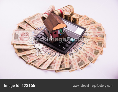 Indian Real Estate Finance and Housing Loan or buying concept showing Rupees, 3D house model, calculator etc