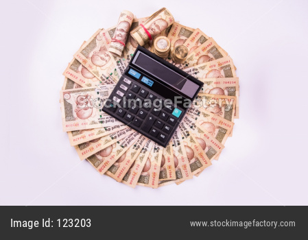 indian currency notes arranged in circular shape with calculator over it