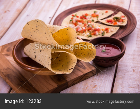 Masala papad is an indian vegetarian crispy food or starter