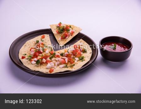 Masala papad is an indian vegetarian crispy food or starter
