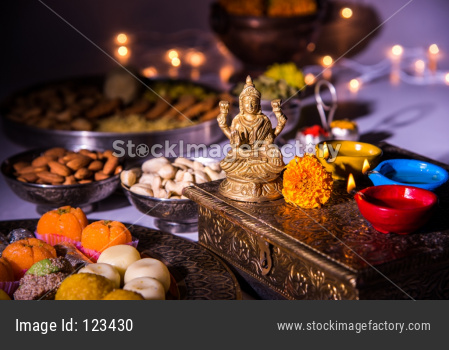 Goddess Laxmi Puja on Diwali with Sweets and Diya