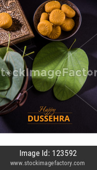 happy Dussehra / Ayudh Puja greeting card with Pedha /Pera and Apta Leaf