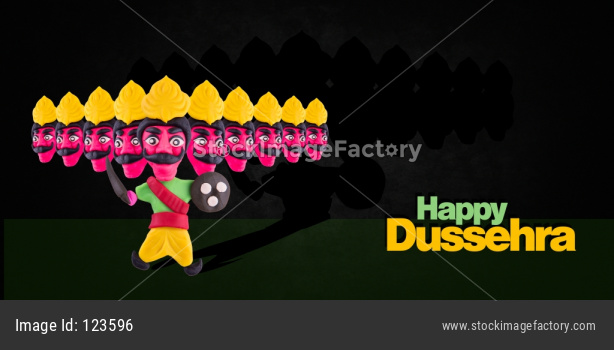 happy Dussehra / Ayudh Puja greeting card with Ravan made using colourful clay or dough