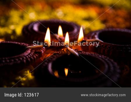 Diwali Diya on Flower Rangoli, selective focus