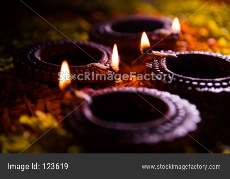 Diwali Diya on Flower Rangoli, selective focus