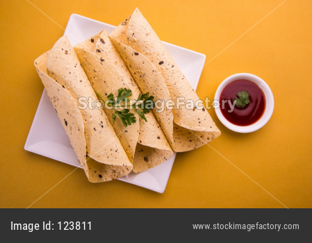 Roasted papad roll is a popular side dish In Indian Lunch/Dinner
