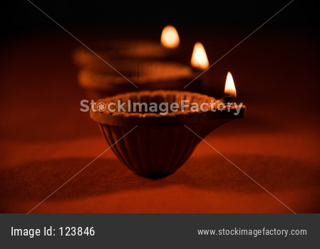 Colourful Diwali diya on colourful background, selective focus