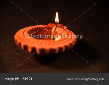 Colourful Diwali diya on colourful background, selective focus