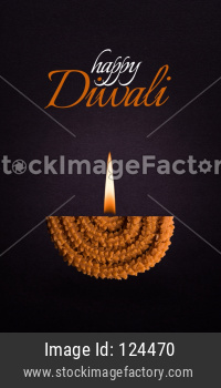 Happy Diwali Greeting card using Half Chakli as a diya with flame added to it
