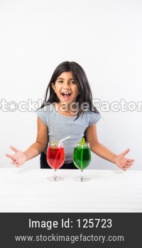 Small girl with cold drink
