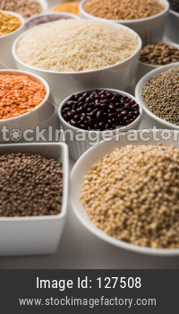 Uncooked pulses,grains and seeds in White bowls