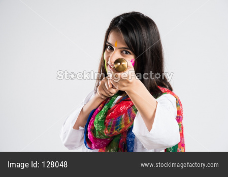 Girl with playing with pichkari on holi