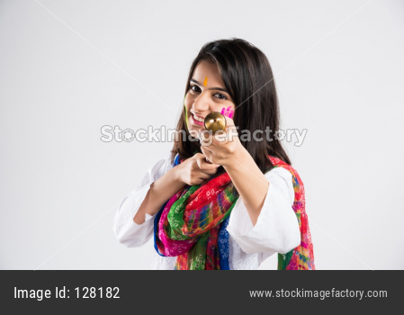 Girl with pichkari on holi