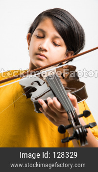 Small Girl playing violin over white background