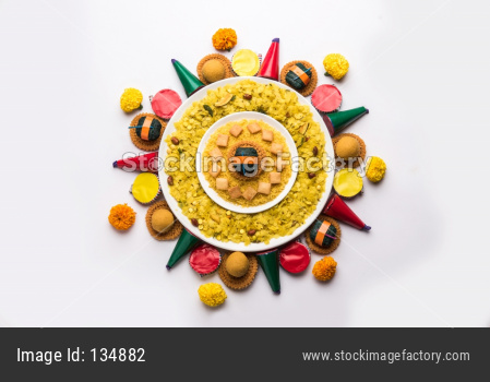 diwali rangoli using snacks, firecrackers and oil lamp or diya