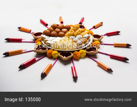 Rangoli made using food, diya and fire crackers