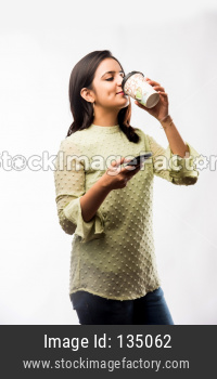Indian girl drinking Coffee