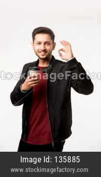 Man having coffee in paper cup