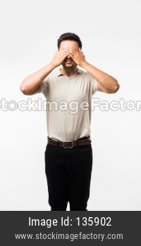 Indian/asian man with hands on eyes