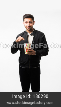 Young Man eating popcorn