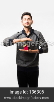 man with house or real estate model