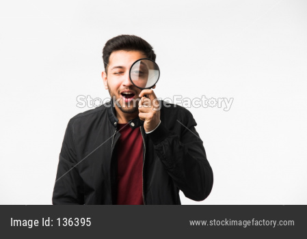 young man with magnifying glass
