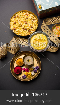 Raksha bandhan Festival : conceptual Rakhi made using plate full of sweets with band
