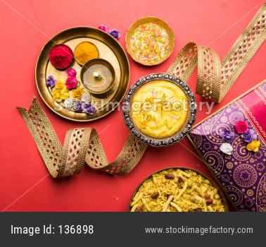 Raksha bandhan Festival : conceptual Rakhi made using plate full of sweets with band