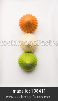 Sweet Tiranga modak shape mithai or dumpling for Independence or republic day greeting card