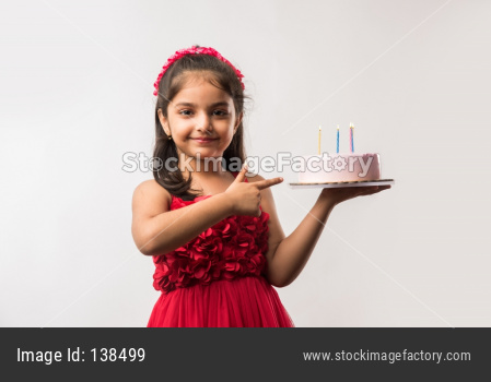 Llittle girl with cake celebrating birthday
