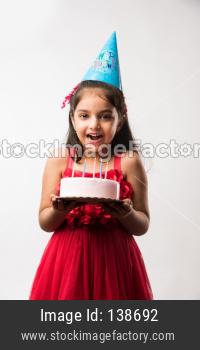 Llittle girl with cake celebrating birthday
