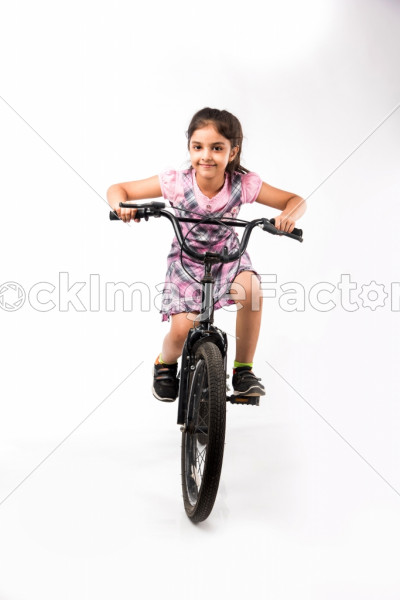 729570db9e1 Cute Little Indian/asian Girl Riding On Bicycle, Isolated Over White  Background Photo 0000138811 - StockImageFactory