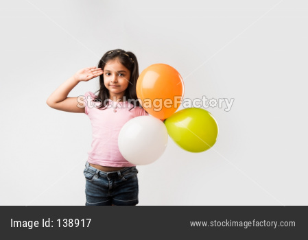 cute little indian girl with tri colour balloons - Saluting national Flag and celebrating Independence or Republic day of India