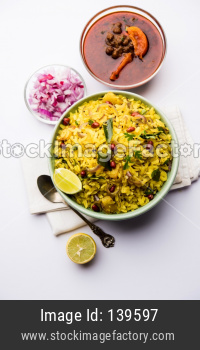 Aloo/Kanda Poha or Tarri Pohe with spicy chana masala/curry. selective focus