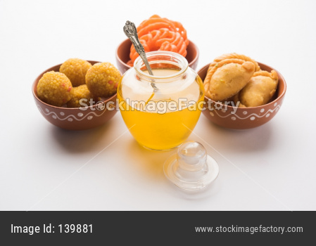 Ghee with Gujiya, motichoor laddu and jalebi