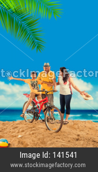 Kid with grand parents playing at beach