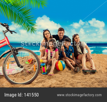 young indian family at beach