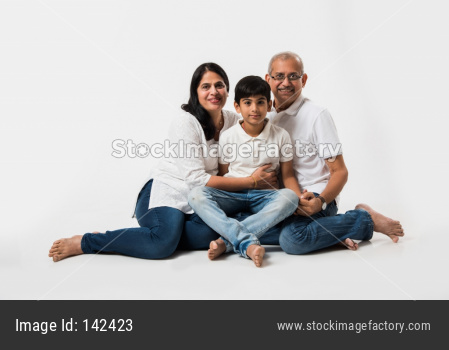 Indian senior couple with grandson, isolated over white