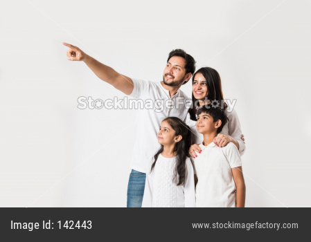 Father pointing finger while standing with family of 4